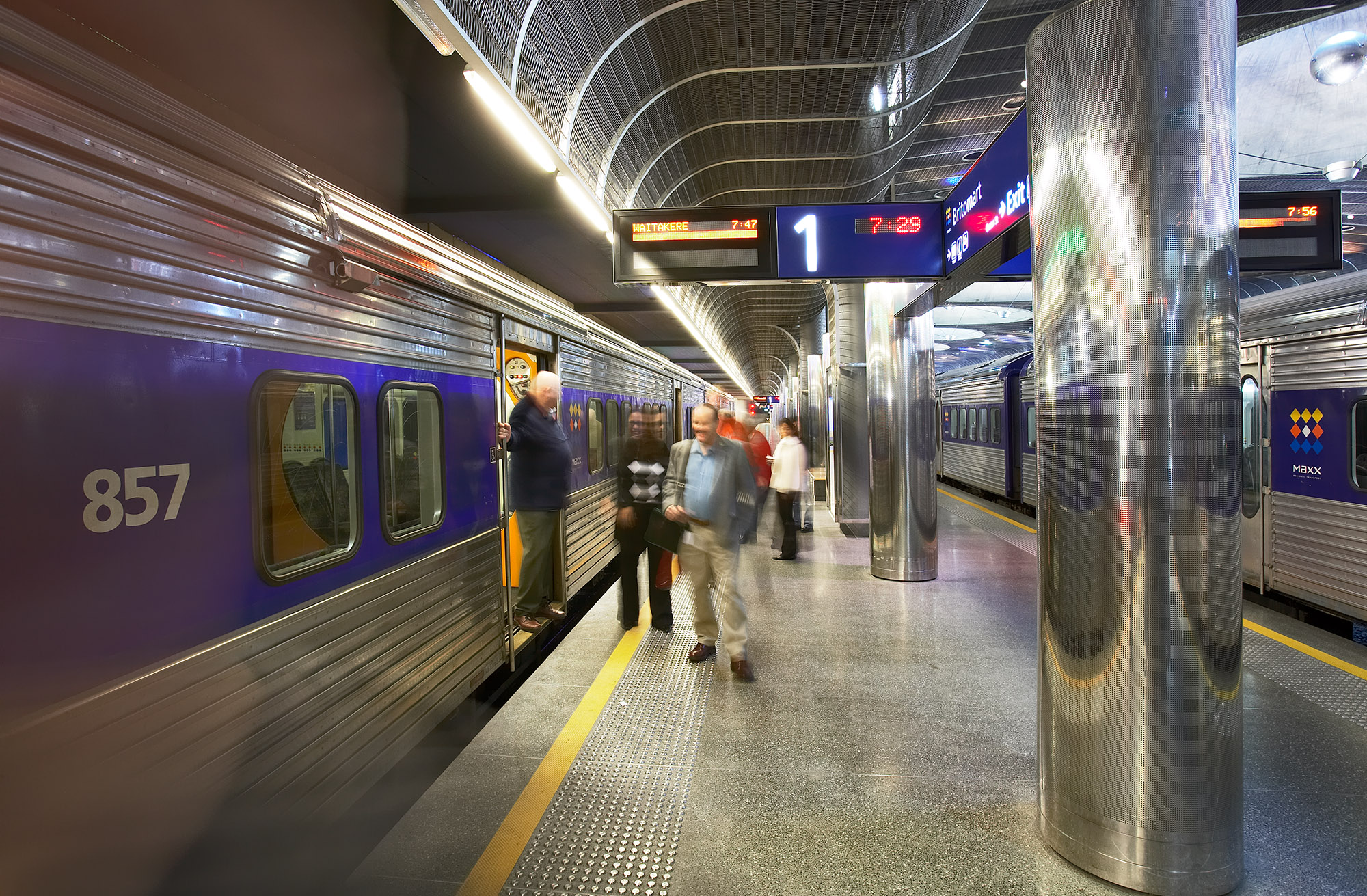 Passengers on platform at Britomart Station with man on left exiting a train